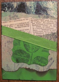 'Green Forest' ATC. Created with alcohol ink, rubber stamping, paint chips, ribbon, book pages, and fire.